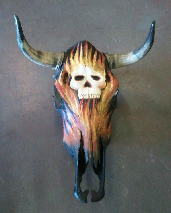Pictures of Painted Cow Skulls http://www.elpasorugs.com/painted_cow_skulls.htm